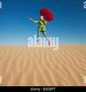 Woman waiting for rain in the desert - Stock Photo