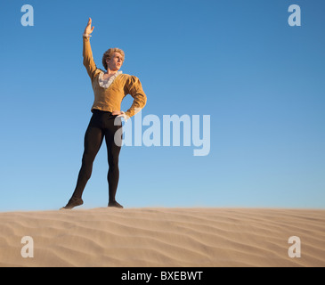 Ballet dancer in desert - Stock Photo