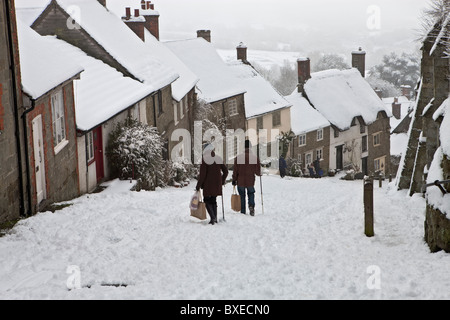 After the winter snow one morning on Gold Hill in Shaftesbury, Dorset - Stock Photo