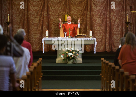 Priest During A Mass At The Altar In The Church Of The