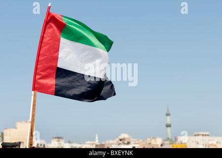Emirates flag in Dubai - Stock Photo