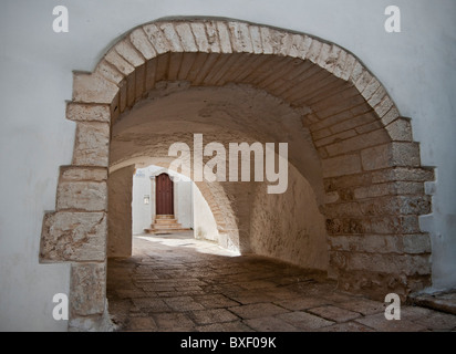 Covered alley in Cisternino, Puglia, Italy - Stock Photo