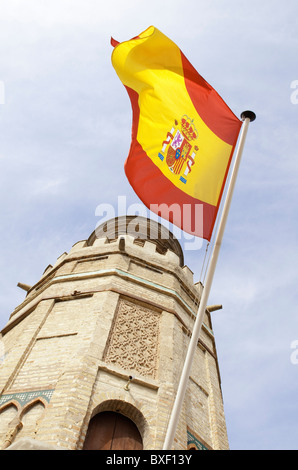 The Spanish flag flies from the Torre del Oro (Gold Tower), Seville, Andalusia, Spain - Stock Photo