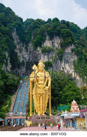 42.7-meter-high statue of the god Murugan on the forecourt of the Batu Caves, limestone caves near Kuala Lumpur, - Stock Photo