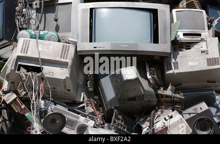 Broken Televisions and computer Monitors ready for recycling, UK - Stock Photo