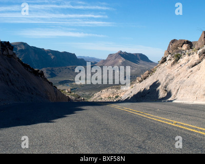West Texas road cresting a hill near the Rio Grande between Terlingua and Presidio, in the Big Bend area. - Stock Photo