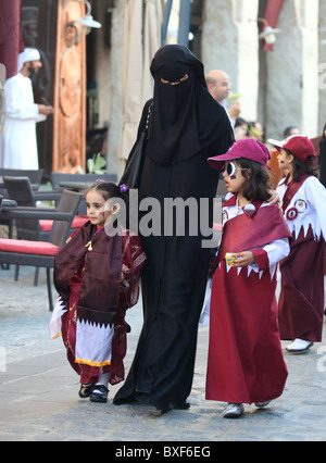 A Qatari family strolling in Souq Waqif on National Day, December 18, 2010. Editorial only, no release. - Stock Photo