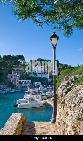 Cala Figuera harbour path with view to fishing boats houses and villas, Palma de Mallorca Balearic Islands Spain - Stock Photo