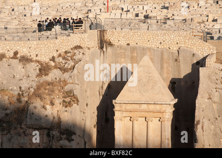 group of orthodox jews praying at tomb on the Mount of Olives from afar above Zaccharias tomb. Jerusalem - Stock Photo