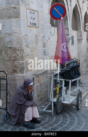 palestinian woman sitting at the corner of Via Dolorosa. Jerusalem Old City - Stock Photo