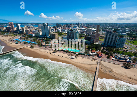 Aerial view of Durban beach front showing the piers extending into the sea. KwaZulu Natal. South Africa. - Stock Photo