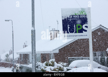 estate agents sign coated in snow on a cold snowy winters day Belfast Northern Ireland