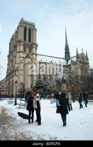 Paris, France, Notre Dame Cathedral, Snow Scene, Tourists Visiting Outside - Stock Photo