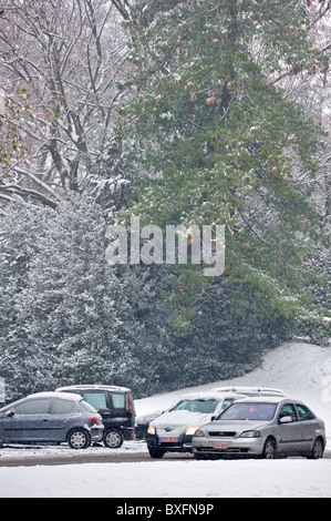 Cars driving on slippery road in winter in the snow, Ghent, Belgium - Stock Photo