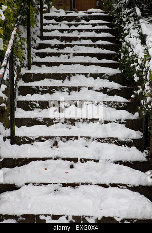 Snow covered steps. - Stock Photo