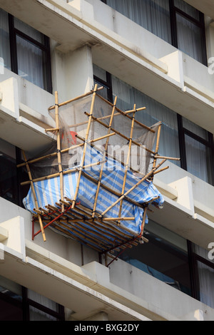 Bamboo scaffolding at a high building in Hong Kong - Stock Photo