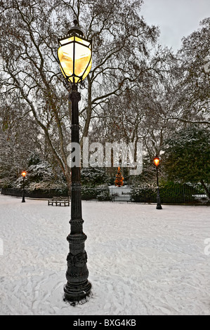 Old gas light, Bedford Square, London, England, UK, Europe, at Christmas in the snow - Stock Photo
