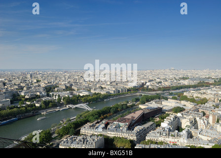 Low Northeast skyline view of the city Paris, from the Eiffel Tower looking towards the River Seine on a warm summer - Stock Photo