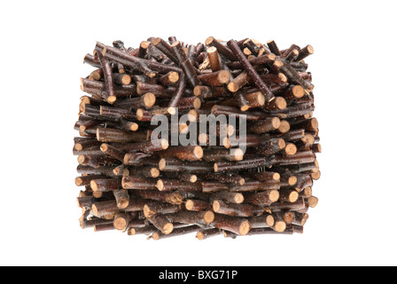 Pile of assorted sawed twigs and branches isolated on white background. - Stock Photo