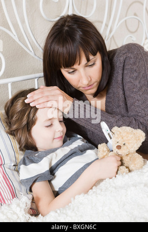 Mother taking care of sick daughter - Stock Photo