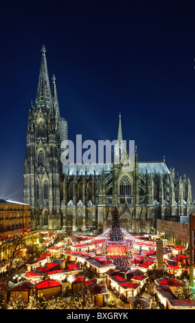 Christmas Market on Roncalli Square in front of Cathedral - Stock Photo