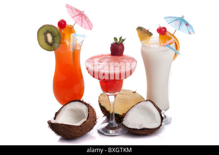 Decorated cocktails (Pina Colada, Strawberry Margarita and Tequila Sun rise) over white background. - Stock Photo