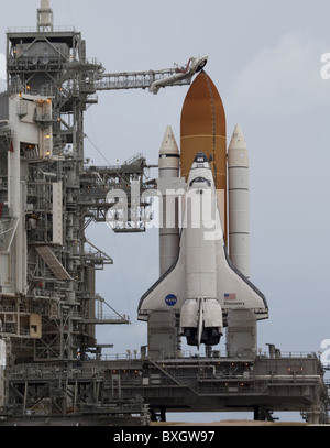 space shuttle Discovery waits patiently on Launch Pad 39A for its STS-133 launch to the International Space Station - Stock Photo