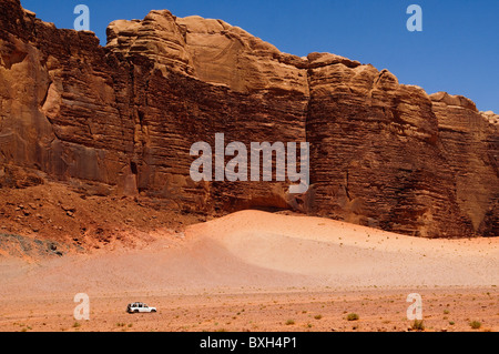 a sea of sand and mountains at Wadi Rum in Jordan - Stock Photo