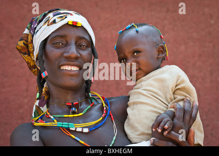 Zemba woman with child in, Opuwo a village near Epupa Falls, Kunene, Namibia, Africa. - Stock Photo