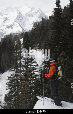 Free skier admiring the wintery mountain landscape at Monte Rosa, Italy. - Stock Photo