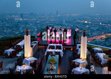 View over open air-bar 'Sirocco Sky Bar' and Bangkok in the evening, State Tower, 247 m, The Dome, Bangkok, Thailand - Stock Photo