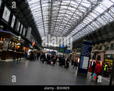 Commuters walk through the main arrival and departure hall of Gare de l'Est. - Stock Photo