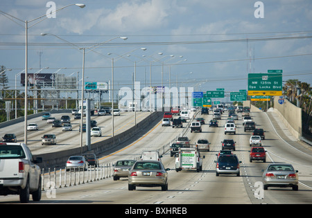 Traffic on the highway heading out of Miami at Opa Locka Boulevard, Florida, United States of America - Stock Photo