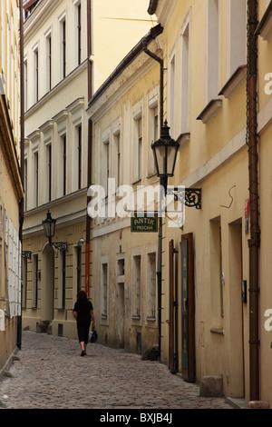 A narrow cobbled street in Old Town, Prague, Czech Republic - Stock Photo