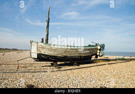 Old fishing boat on Dungeness beach. Flaking paint. - Stock Photo
