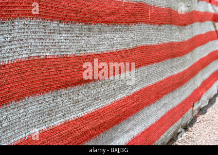 drop cloth red and white nylon used on construction sites - Stock Photo
