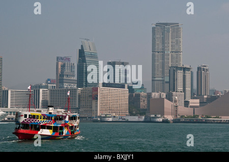 Star Ferry crossing Victoria Harbour towards Kowloon, Hong Kong, China - Stock Photo