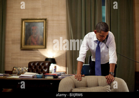 President Barack Obama talks on the phone - Stock Photo