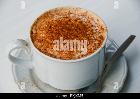 Café latte in cup on restaurant table - Stock Photo