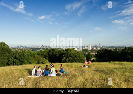 People at the top of Parliament Hill, Hampstead Heath, London, England, UK - Stock Photo