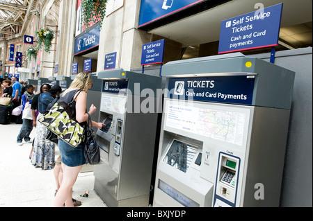 People using train ticket machines at Waterloo Station, London, England, UK - Stock Photo