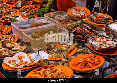 Unique weird plates of food on display at ourdoor restaurant in downtown Hong Kong China - Stock Photo