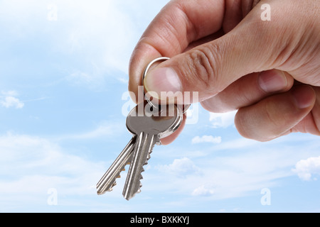 Handing over house keys - Stock Photo