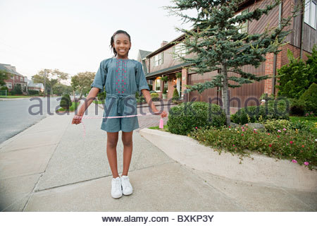 Young girl with skipping rope - Stock Photo