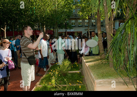 Adults Visiting Paris, France, Garden Festival, Champs-Ely-sees Farmer's Event - Stock Photo