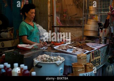 Street food stall, Tai O village, Lantau island, Hong Kong, China - Stock Photo