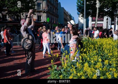 Crowd of Tourists Visiting Paris, France, Garden Festival, Man taking photos on street - Stock Photo
