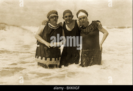 bathing, young man embracing two women, probably his wife and his mother-in-law, Sylt, near Westerland, Germany, - Stock Photo