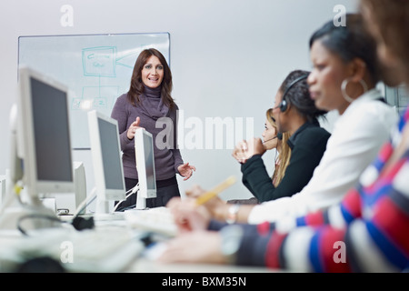 multiethnic group of female customer service representatives in a meeting, adult businesswoman talking. - Stock Photo