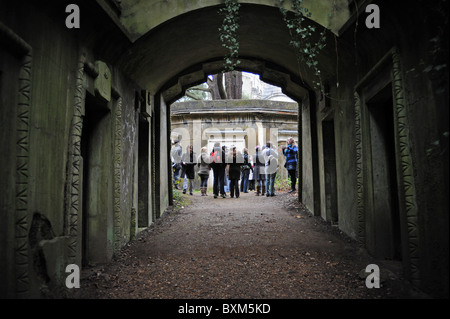 Visitors on a tour at Highgate Cemetery, North London, England - Stock Photo